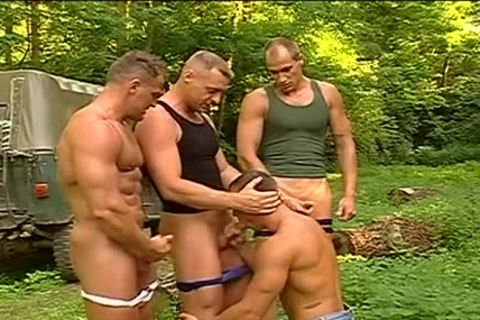 men show some muscle in the woods